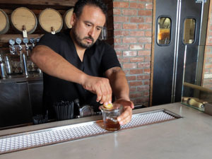 Tri Tip Company general manager Paul Garcia makes an Old Fashioned at