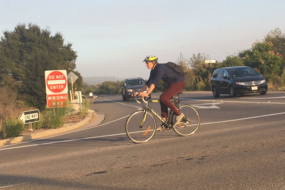 A bicyclist cruises on Los Carneros Road in Goleta. The city is considering making changes to several key intersections to make them safer for bicyclists and pedestrians.