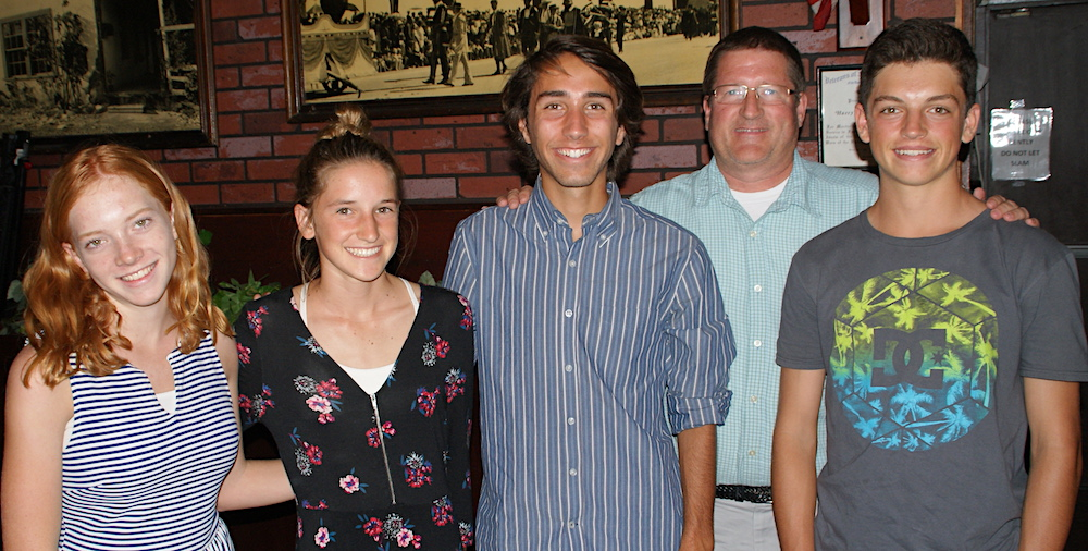The San Marcos cross country team was represented by, from left: Anna Chase, Madi Funk, Ty Burre, coach William Stehmeier, and Will Snyder. The Royals run at the Channel League No. 2 meet on Thursday at Lake Casitas.