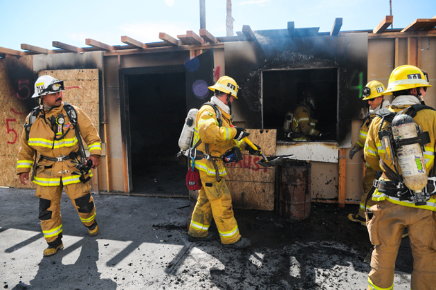 Santa Barbara city firefighters conduct a training drill Thursday at a structure on South Olive Street. (Lara Cooper / Noozhawk photo)