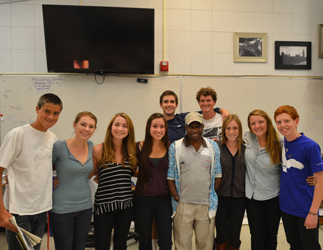 Rwandan genocide survivor Frederick Ndabaramiye, center, visits with San Marcos High School students, from left front row, Nolan Cope, Caitlin Walker, Sarah Kelmenson, Crystal Hart, Evyn Van Homer, Sara Scott and Jacob Iuele, and, back row, Chris Newton and Jason Phreaner. (Jamie DeVries photo)