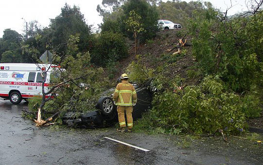 A motorist escaped injury Tuesday afternoon after he lost control on northbound Highway 101 and his car went over the embankment at Carrillo Street, landing on its roof on the ramp.