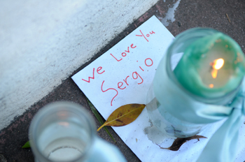 Handwritten notes are part of a memorial for 15-year-old Sergio Romero outside JAMS on Milpas Street in Santa Barbara.