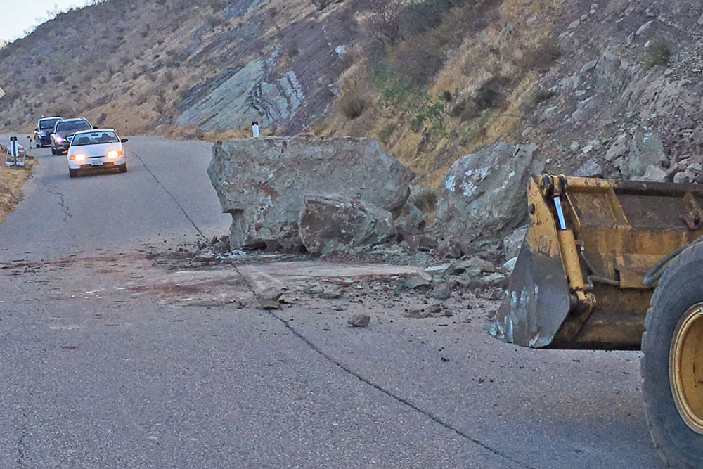 A large boulder tumbled onto San Marcos Road in the hills above Santa Barbara on Thursday. No injuries were reported, and crews were able to shove the rock off the road for eventual removal.