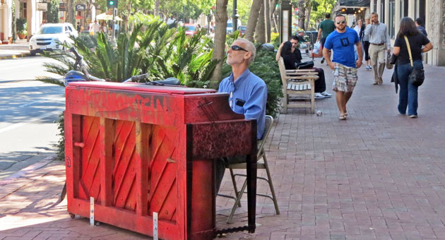 <p>Santa Barbara acupuncturist Dan Diamond pauses to play some tunes during his lunch break this week at one of several pianos placed along State Street, courtesy of Pianos on State.</p>