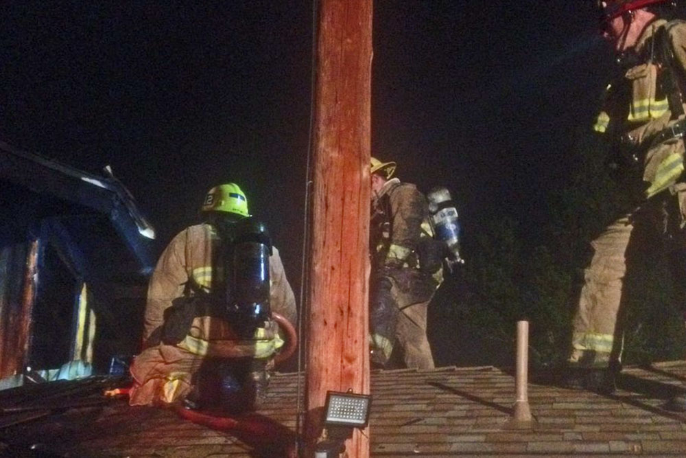 Firefighters battled an attic fire that broke out early Friday in a guest house behind a residence on the 1400 block of North San Marcos Road. A newly installed wood stove may have sparked the blaze.