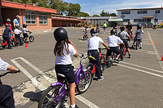 St. Mary's School students line up for a safety and riding lesson.