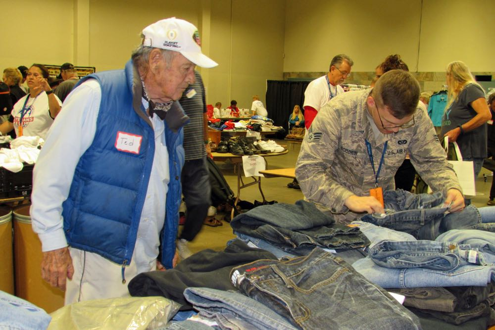 Veteran Ted Strangman of Buellton looks at pants with help from Senior Airman Justin Goodwin at the Fifth Annual Santa Barbara County Veterans Stand Down on Saturday in Santa Maria.