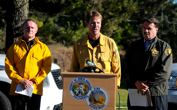Lookout Fire Incident Commander Mark vonTillow speaks at a news conference late Wednesday afternoon as Fire Chief Michael Dyer, left, and Sheriff Bill Brown look on. (Lara Cooper / Noozhawk photo)