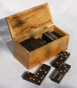 Among my woodworking creations are domino sets made of exotic woods. (Paul Burri / Noozhawk photo)