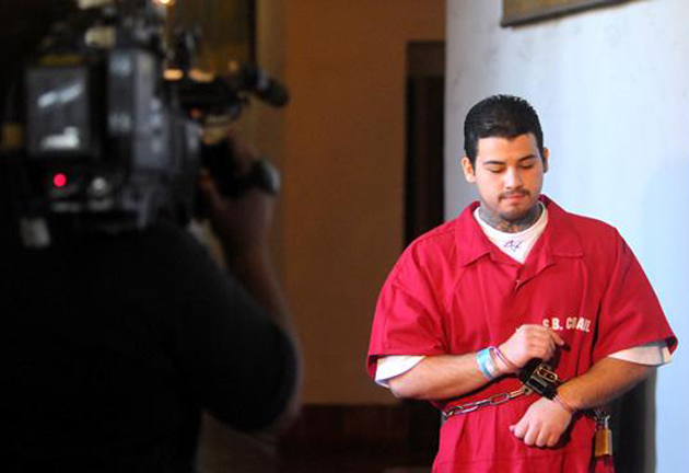 Murder suspect Adrian Robles is greeted by cameras during a lunch break in his preliminary court hearing in August 2010. On Wednesday, attorneys delivered their opening statements in his trial. (Lara Cooper / Noozhawk file photo)