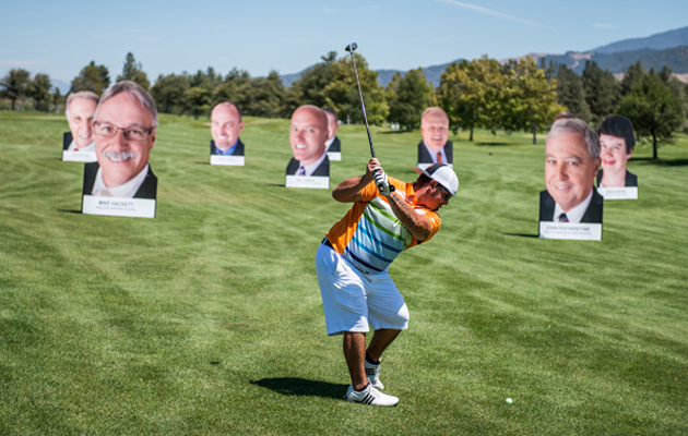 <p>Participant Sean Foy takes a shot at a novelty hole during the ninth annual Chumash Charity Golf Classic.</p>