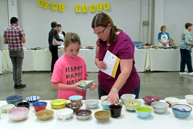 Savannah, left, and Dana Moody make their selections from a variety of ...