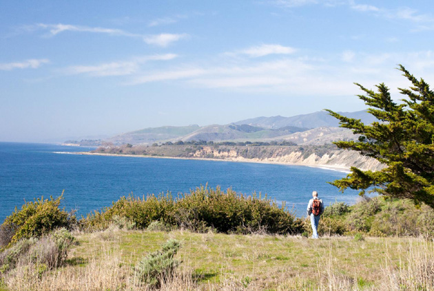 Hiking along the Gaviota coast bluff top on the California Coastal Trail proposed by the Santa Barbara Trails Council. A current development proposal would place the route north of Highway 101 and more than a mile from the bluff top. (Santa Barbara Trails Council photo)