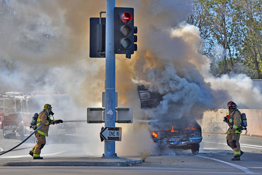 Firefighters attack the flames from a motorhome that was destroyed by fire Wednesday on the Hope Avenue offramp from northbound Highway 101 in Santa Barbara. No injuries were reported.