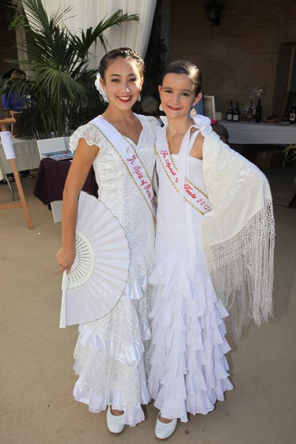 Fiesta Junior Spirits Jesalyn MCollum and Sadee Broida pose in their white dresses.
