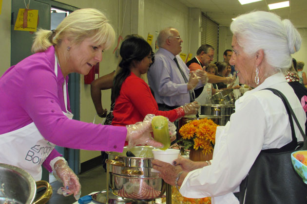 Santa Maria Mayor Alice Patino is served a bowl of soup by KSBY news personality Jeanette Tompeter Wednesday during the Empty Bowls event at the Santa Maria Fairpark.