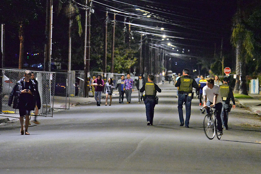 In contrast to previous years, sheriff's deputies patrol a largely deserted Del Play Drive in Isla Vista on Friday night at the beginning of the four-day Halloween weekend.