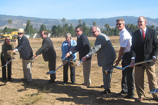 Digging in for their Cabrillo Business Park photo opportunity Thursday were, from right, Sares-Regis Group's Russ Goodman; Goleta City Coiuncilmen Eric Onnen and Michael Bennett; Sares-Regis' Steve Fedde; City Councilwoman Margaret Connell; Mayor Roger Aceves; Councilman Ed Easton; and Patty Miller, who has overseen the project since its conception, first in a planning position at Santa Barbara County and now as Goleta's planning manager.