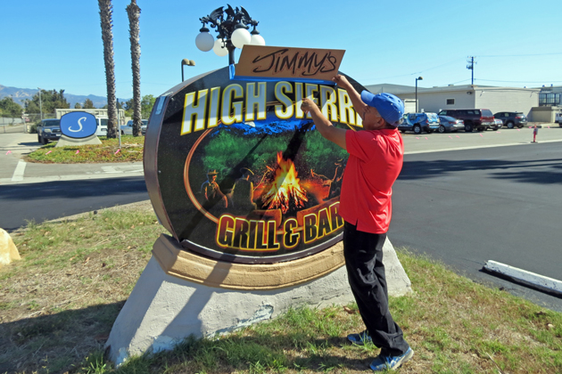 High Sierra Grill co-owner Mario Medina unveils the new sign ahead of a planned Dec. 7 opening.