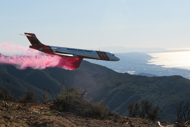 Tankers coat the hills with flame retardant Thursday.