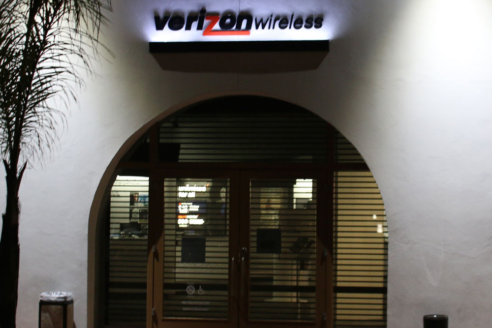 Two men — including one wearing a Batman costume — escaped with cash and merchandise Tuesday night after the take-over armed robbery of a Verizon Wireless store in Santa Barbara.