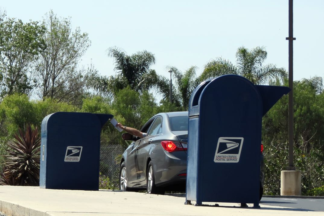 The U.S. Postal Service has eliminated overnight mail delivery of letters, meaning letters dropped off locally — such as at this Storke Road postal facility in Goleta — will arrive two days later, regardless of address.