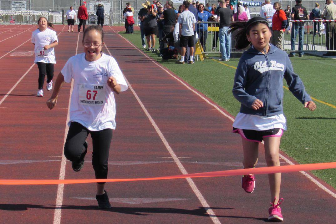Special Olympians race to the finish line Saturday at Pioneer Valley High School in Santa Maria.