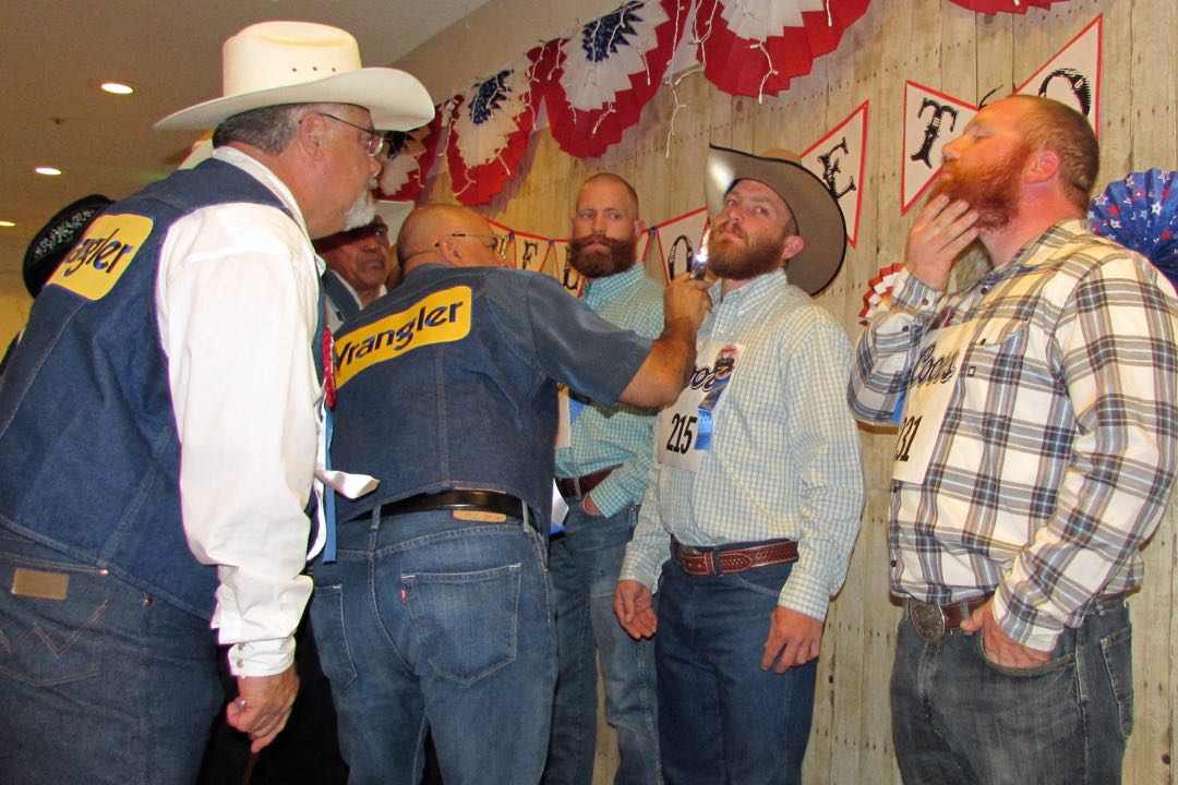 Judges move in for closer looks at contestants vying to win the reddest facial hair title at the annual Beard-A-Reno competition, one of many events leading up to the Santa Maria Elks Rodeo from May 28-31.