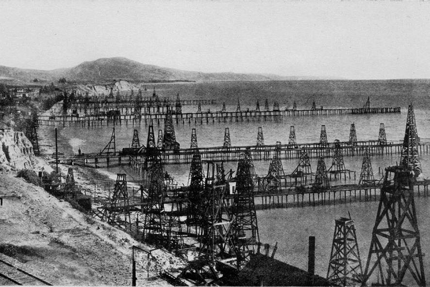 In the late 1800s and early 1900s, Summerland Beach was bustling with offshore drilling activity, with hundreds of wells pumping out oil and gas from fertile fields below the Santa Barbara Channel. This photo was taken from Ortega Hill, circa 1920.