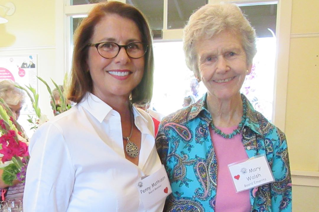 Guests at Friendship Center's Sixth Annual Wine Down event were greeted by longtime supporters Penny Mathison with longtime supporter Mary Walsh.
