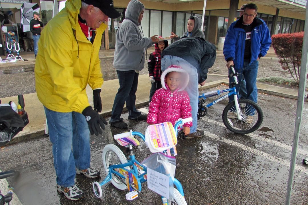Nyah Ingram, 3, is presented with her new bicycle.