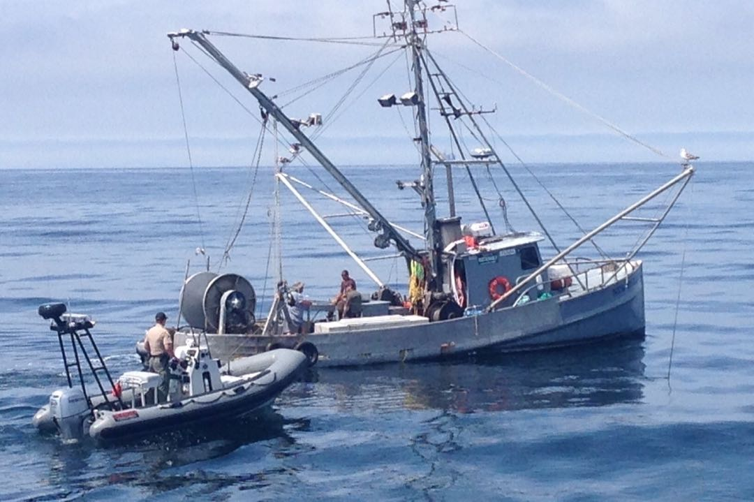 California Department of Fish and Wildlife officers intercept a commercial fishing boat that was fishing in a closed area a few days after the Refugio Beach oil spill.