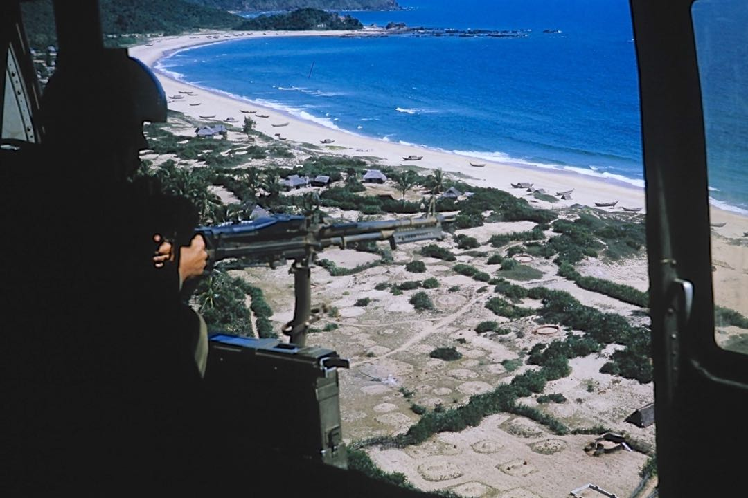 A door gunner remains at the ready while his helicopter patrols the coast of Vietnam. This photo and many other will be on display as part of the Pierre Claeyssens Veterans Foundation-Channel City Club symposium on the Vietnam War, which is scheduled for Sept. 9 at The Fess Parker in Santa Barbara.