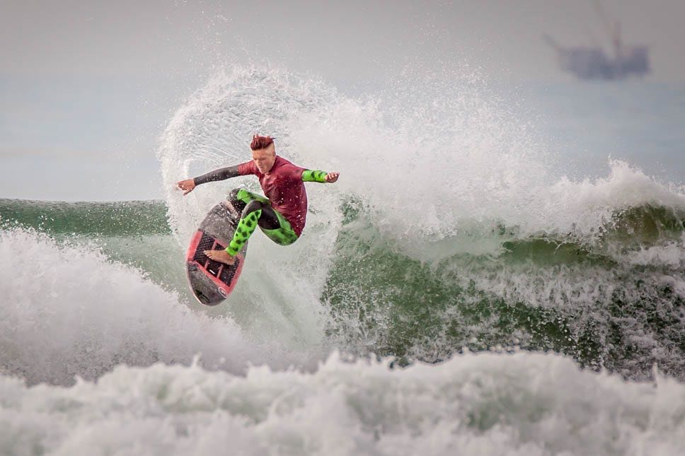 A surfer carves out a move during Saturday's Rincon Classic surfing competition at Rincon Point.