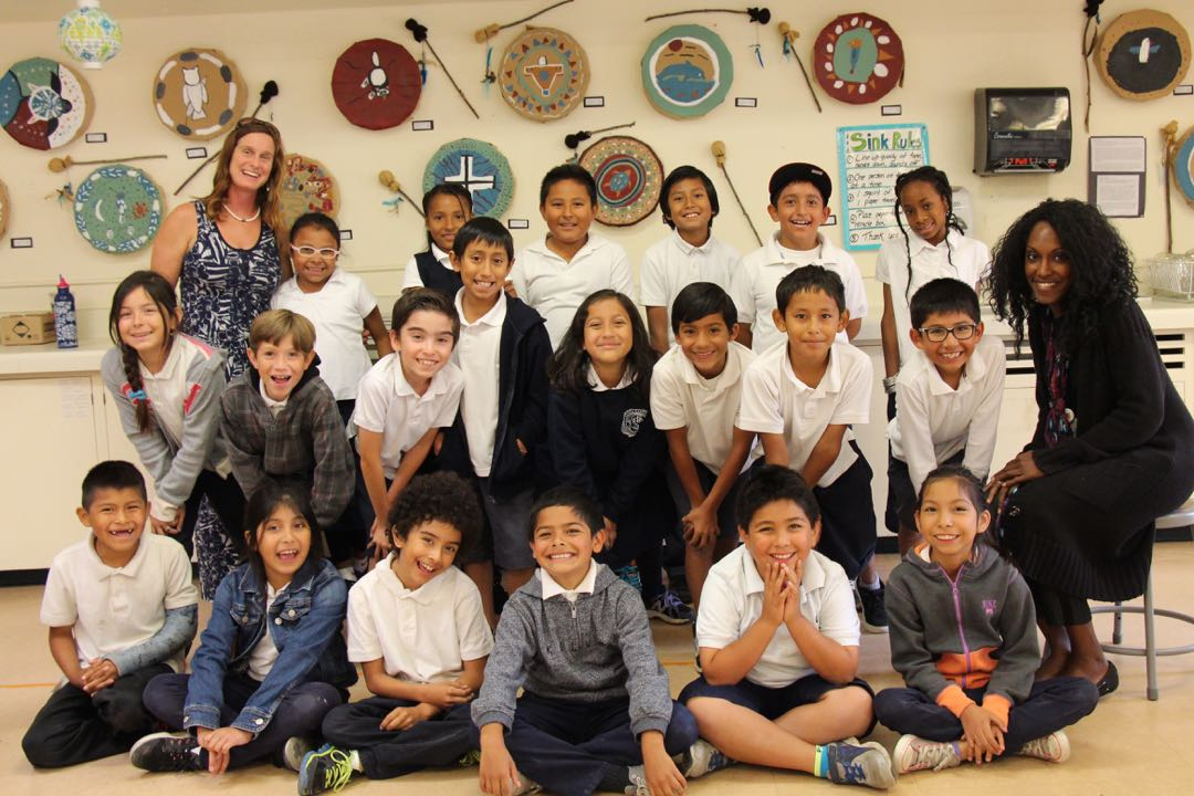 Santa Barbara Community Academy students gather for a group photo with third-grade teacher Shawna Thrower, right, and Rachel Kauffman, an art assistant with iCAN's Visual Arts Program.