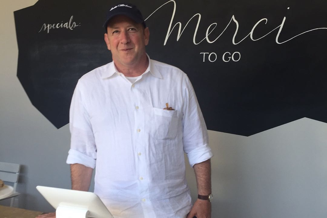 Montecito Country Mart owner Jim Rosenfield stops by newest tenant Merci to Go, which served up delicious gourmet items during Saturday's country fair.
