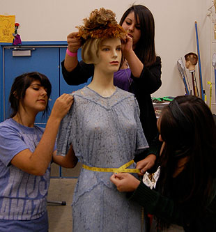 A mannequin gets the 'Fearsome Foursome' treatment as Dos Pueblos Charger Theater prepares for the opening of