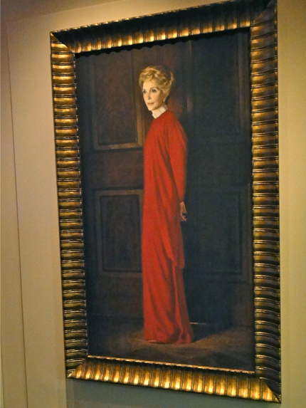 First lady Nancy Reagan's official White House portrait, in her famous Reagan Red column gown.