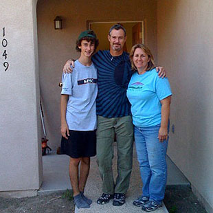 Westmont psychology professor Tom Fikes and his family — Jerolyn, right, and Tobin — are excited to be back in a home of their own.