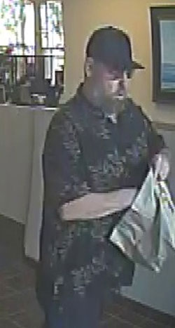 A surveillance photo shows a man who held up the Union Bank branch at 299 N. Fairview Ave. in Goleta on Monday.