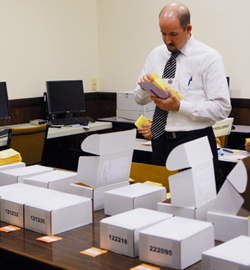A Santa Barbara elections worker stays late to count ballots. Vote-counting for the city's first mail-only election continued into the early hours Wednesday