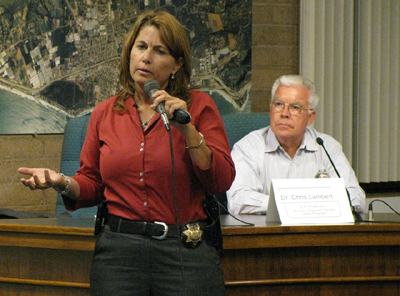 Santa Barbara County sheriff's Sgt. Sandra Brown said she has seen plenty of drug- and alcohol-related overdoses in her work, while panelist and physician Chris Lambert, background, spoke about the overdose patients he treats in the Cottage Health System's emergency rooms.