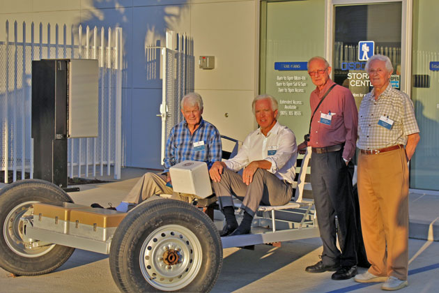 From left, engineer Paddy Mills, Investec president Kenny Slaught, and engineers Jerry Compton and Ferenc Pavlics pose with a rover brought over by Mills.