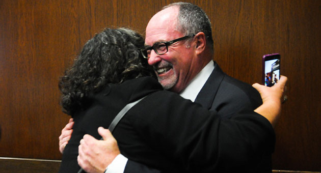Santa Barbara City Councilman-elect Gregg Hart gets a congratulatory hug from Councilwoman Cathy Murillo after winning an open seat in the Nov. 5 election. (Lara Cooper / Noozhawk file photo)