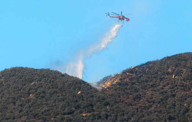 A chopper makes a water drop near the Cold Springs Trail just after 2 p.m. Tuesday.