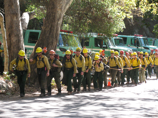 A U.S. Forest Service hand crew heads to the fire lines.