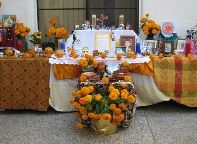"Visiting Nurse & Hospice Care has commemorated the Latin tradition of Día de los Muertos by decorating an altar, or ""ofrenda,"" with mementos, marigold flowers and photos of loved ones who have passed. (Visiting Nurse & Hospice Care photo)"