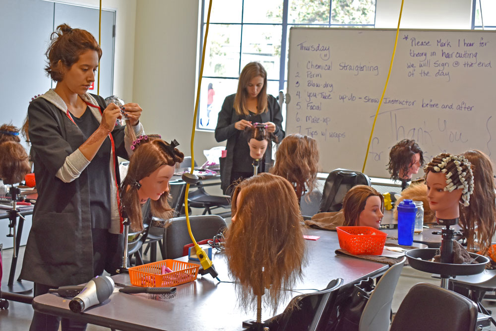 Santa Barbara City College Cosmetology Academy students practice on mannequin heads at the new downtown Santa Barbara location on Anacapa St.