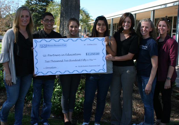 Representatives of the Human Resources Club at UCSB present a $2,250 check from fundraising proceeds to The Academy at Dos Pueblos High School. (The Academy at Dos Pueblos High School photo)